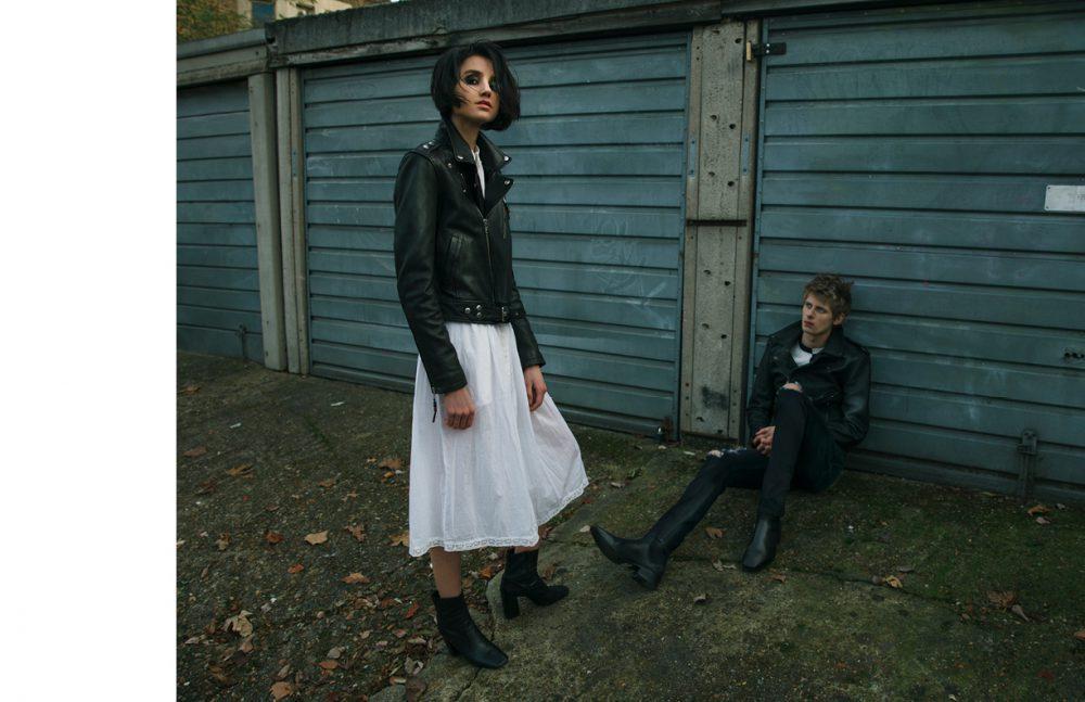 Matt wears Jacket & Trousers / BLK DNM Top / Maison Kitsuné Shoes / Casely-Hayford Elle wears Jacket / BLK DNM Dress / Zadig & Voltaire Shoes / Stylist's Own