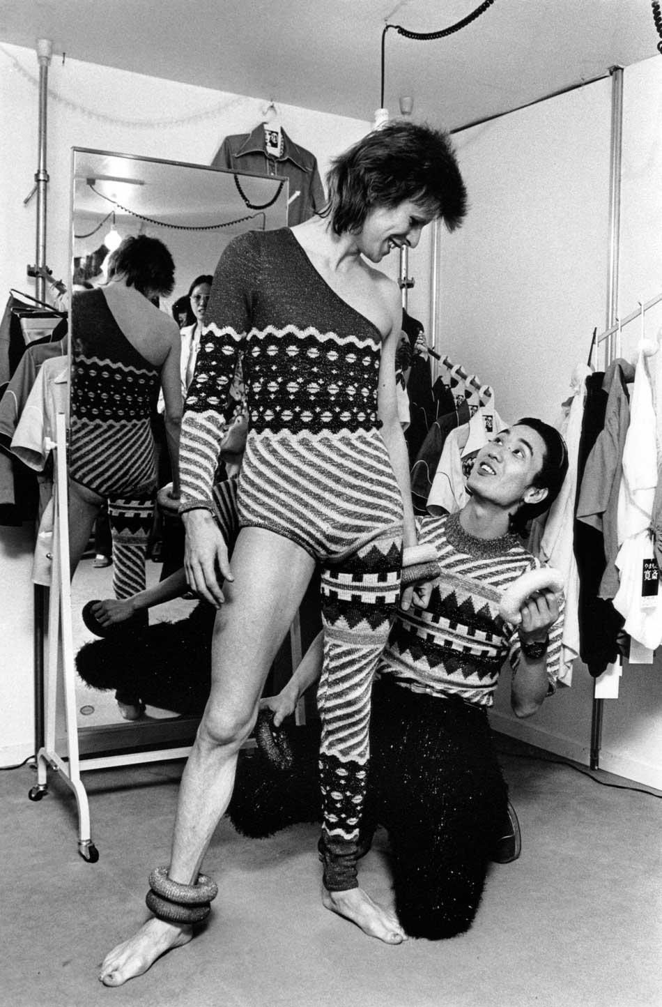Asymmetric knitted bodysuit, 1973 Designed by Kansai Yamamoto for the Aladdin Sane tour /  Photograph by Masayoshi Sukita © Sukita The David Bowie Archive 2012