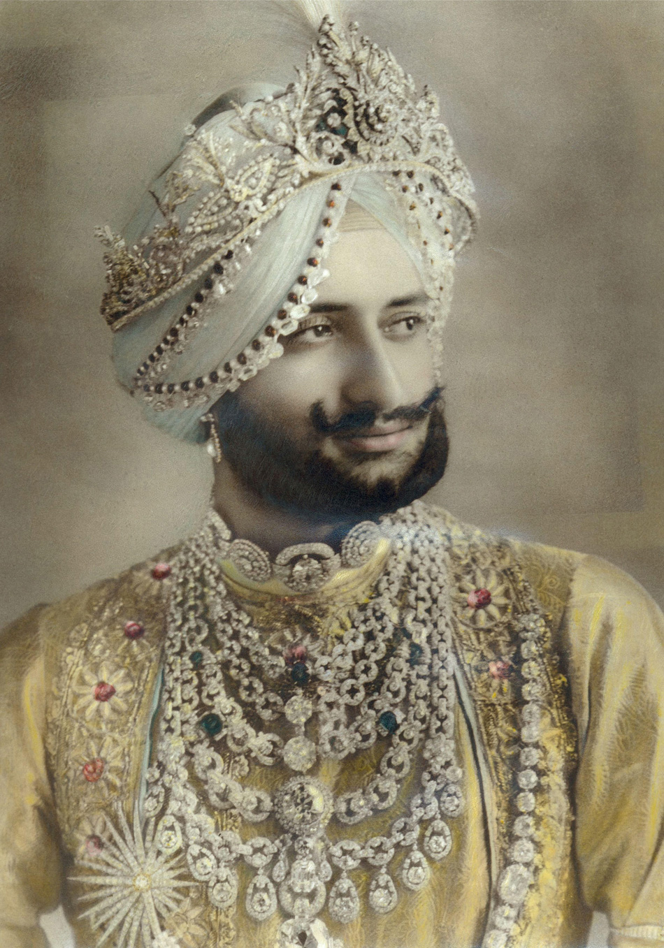The Maharajah of Patiala In this 1928 photograph from the New York Herald, Sir Yadavindra Singh, Maharaja of Patiala, wears a platinum-and-diamond ceremonial necklace created by Cartier for his father, Sir Bhupindar Singh. © Cartier Archives