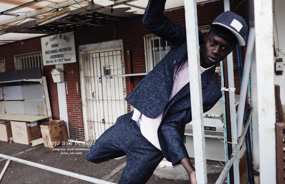 Alpha Dia @ Modelwerk wears Suit / COS Poloshirt / Topman Cap / Carhartt