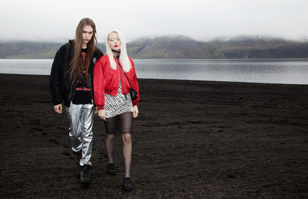 Rafn Ingi wears Bomber Jacket / Schott  Hoodie / Off-white  T-Shirt / Spúútnik  Trousers / Diesel  Boots / Timberland Bryndis wears Red Bomber Jacket / Schott Net Dress & Choker / Hildur Yeoman  Tights / FALKE Zebra Dress & Shoes / Spúútnik  Earrings / Fashionology Bag / Carven