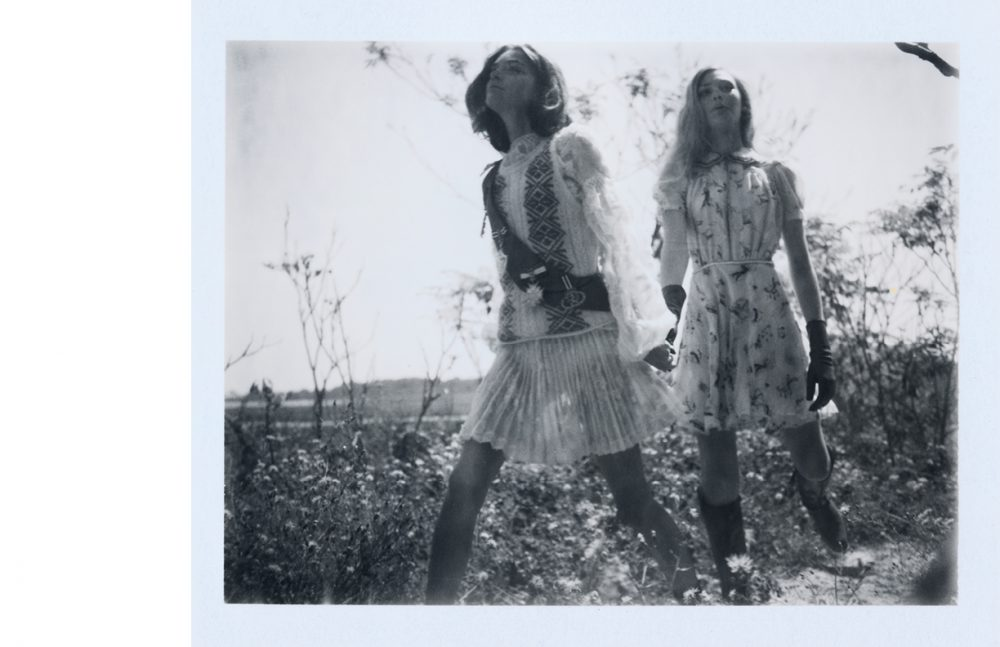 Cornelia wears Blouse, vest & skirt / Moncler Gamme Rouge  Sash / Erickson Beamon Boots / Dear Frances Maggie wears Dress / Hilfiger Collection  Gloves / Hestra Boots / Ariat