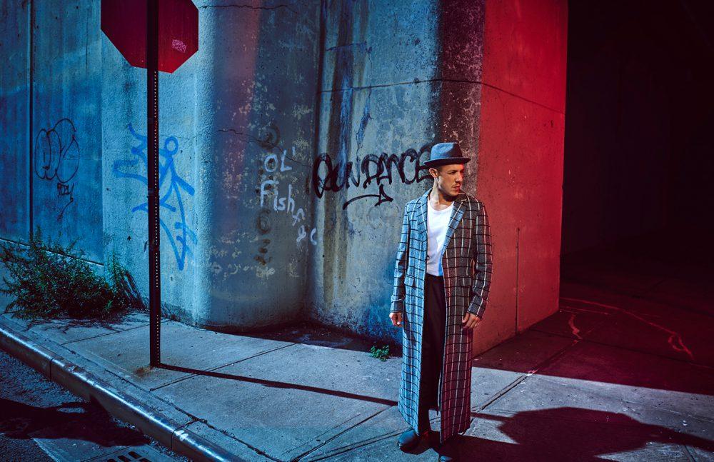 Coat / Pyer Moss T-Shirt / En Noir Jeans / Theory Hat / The Goorin Bros. Boots / Dr. Martens
